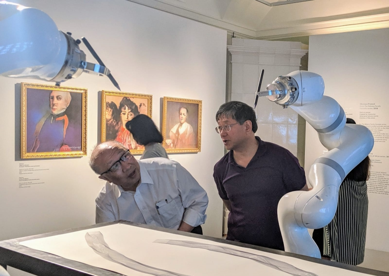 Council members Dr. Wei Zhao and Xi-Cheng Zhang exploring the Art&Science exhibition at the State Hermitage Museum