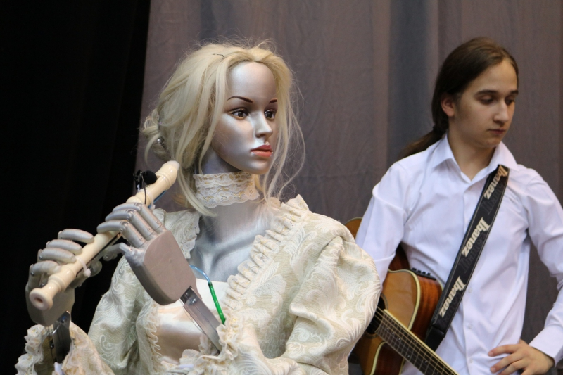 Robot ELSA and guitar player